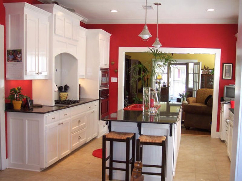 red walled kitchen with white cabinets cabinet cures inc