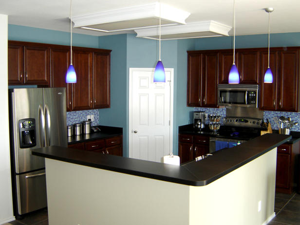 blue kitchen with black counters and cherry cabinets cabinet cures inc